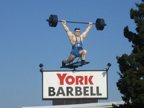 The famous York Barbell spinning Weightlifter.
