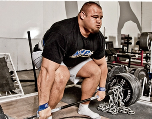 "World's Strongest Man Brian Shaw is 6'8"", 400lbs+. His large frame and core necessitate a wider stance and a wider grip to make room for his body parts."